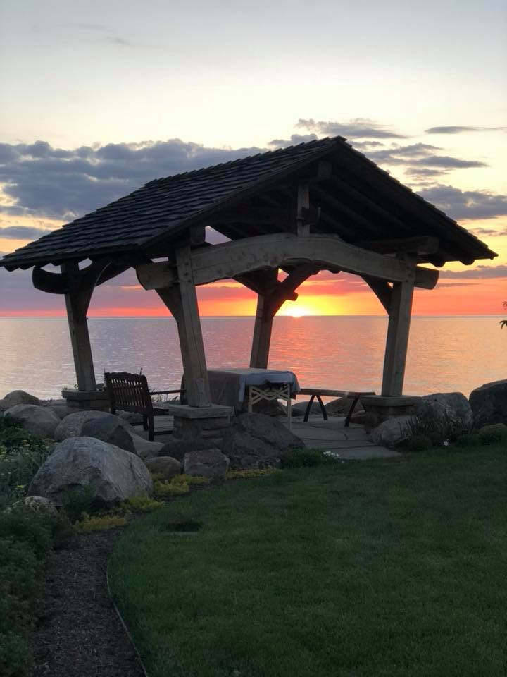 Massage pavilion in front of a colorful Lake Erie Sunset