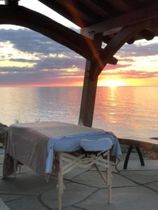 Massage Table Near Calm Lake Erie Setting at Sunset